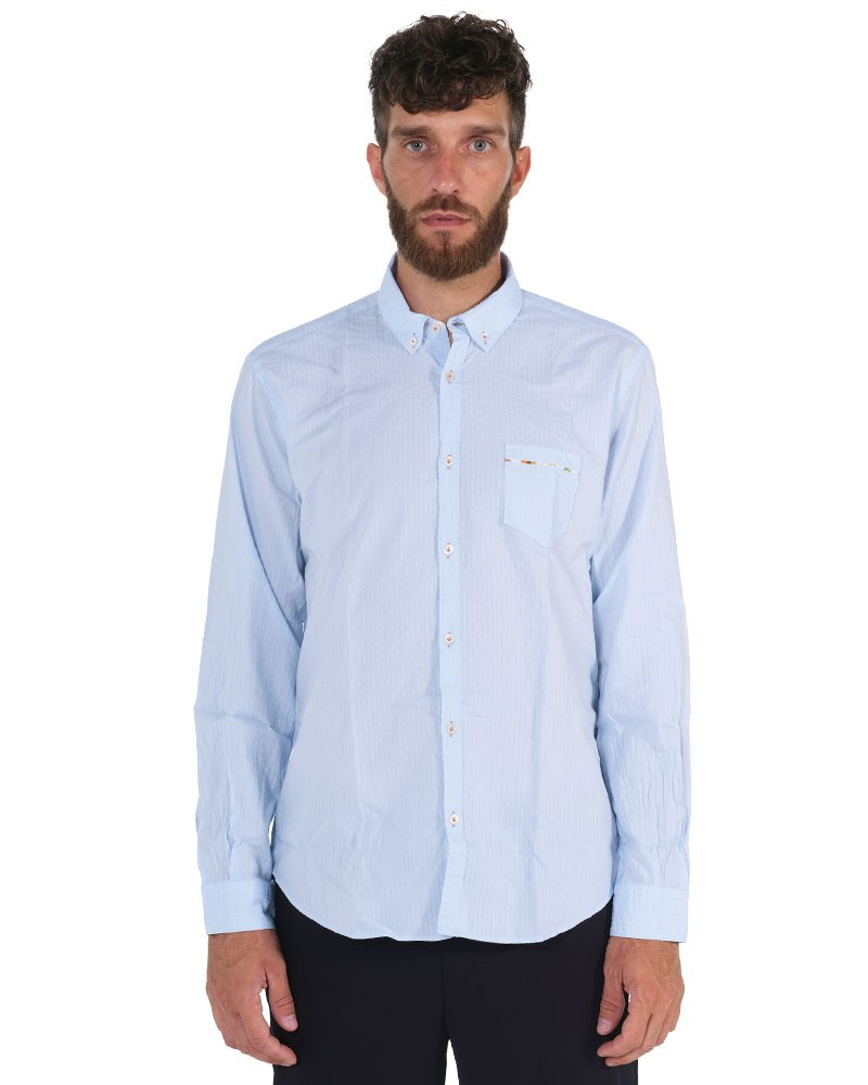Light blu shirt . Soft Collar.